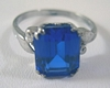 Sterling Ring by Uncas with a Emerald Cut Sapphire