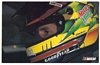 Postcard NASCAR Kyle Petty sitting in # 42 Race Car with helmet